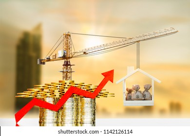 Stack coin is home and arrow graph with growing value and tower crane with build a house and money bag on blur cityscape background, Loan and business investment for construction real estate concept.