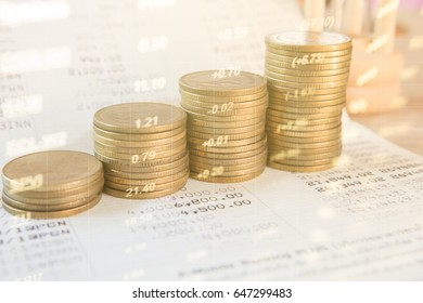 Stack coin money with account book finance and banking with profit graph of stock market trade indicator financial.Double exposure style