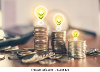 stack of coin with tree growing in light bulb ,idea for business growth,investment and green saving environment concept