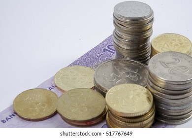 Stack of coins and bank note on white . Money concept for business.