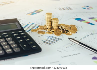 Stack of coins with calculator and a pen on paper graph at office, Business Finance and money saving concept.