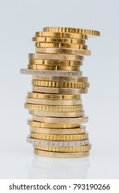 stack of coins in front of white background