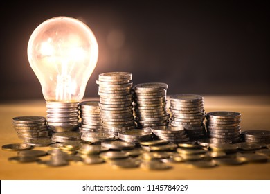 Stack of coins and light bulb for saving money concept, Creative ideas of business planning, success in the future.