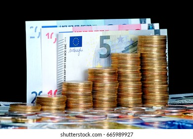 Stack of coins with note as background