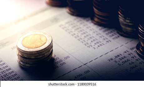 Stack of coins on account book.Business and financial concept.Estimated budget for save money and retirement planning.Free space.