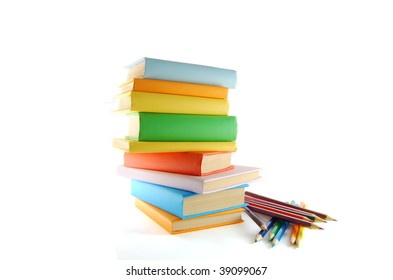 A stack of color books and pencils on the white background