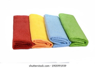 Stack of color microfiber cloths isolated on white. Row of Colorful microfiber towels.