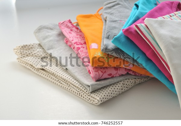 stack Colored clothes on a white background