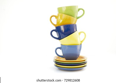 stack of colored cups and plates