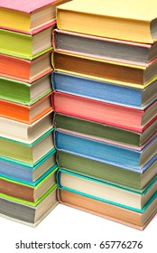 Stack of colored hard covered used books