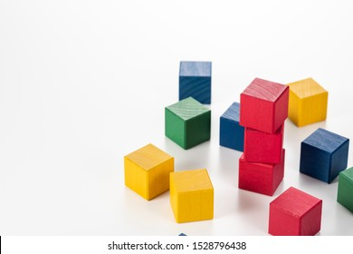 Stack colorful blocks. White background.