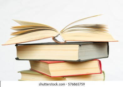 a stack of colorful books in a library or a room isolated on white background