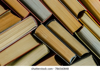 a stack of colorful books in a library or a room. book stack background, education background, back to school concept