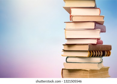 Stack of colorful books on  background