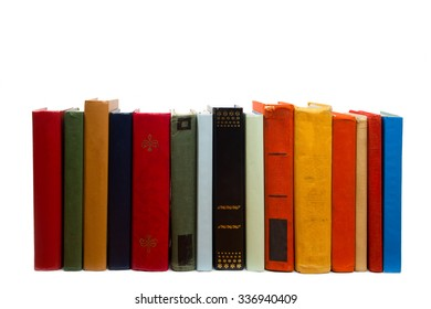 Stack of colorful books on wooden shelf isolated on white background. Back to school. Copy space for text