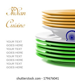 Stack of colorful ceramics plates on white background in orange, white and green, colors of Indian flag, illustrating concept of Indian food and cuisine