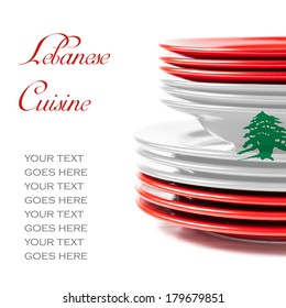 Stack of colorful ceramics plates on white background in white and red, colors of Lebanese flag, illustrating concept of Lebanese food and cuisine