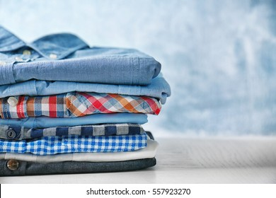 Stack of colorful clothes on blue background