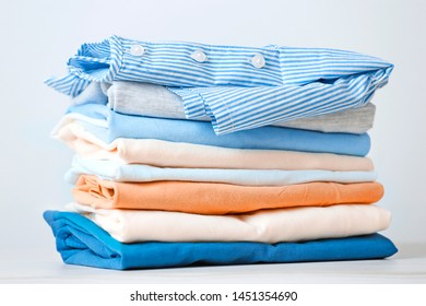 Stack of colorful cotton clothes. Heap of   folded laundry.Stacked apparel.
