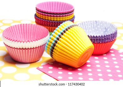 stack of colorful empty cupcake cups