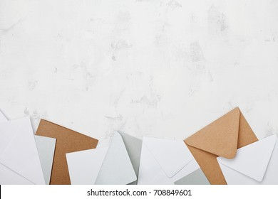 Stack of colorful envelopes on working desk top view. Business mail, blogging and office correspondence background. Flat lay.