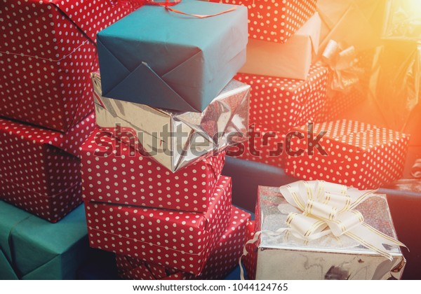 Stack of colorful handmade gift boxes, sunlight effect, toned