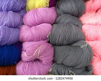 Stack of colorful knitting wool, Knitting is a method by which yarn is manipulated to create a textile or fabric, often used in many types of garments