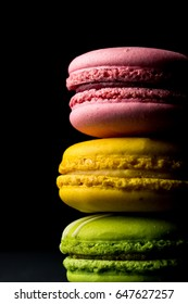 Stack of colorful macaroons on black