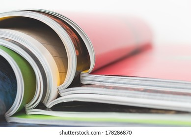 A stack of colorful magazines up close