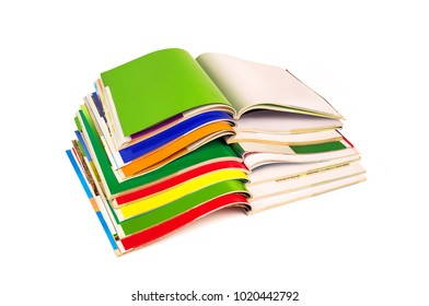 stack of colorful magazines isolated on white background