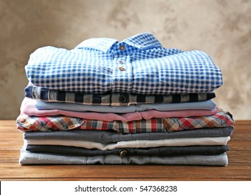 Stack of colorful shirts on table