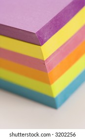 Stack of colorful sticky notes.