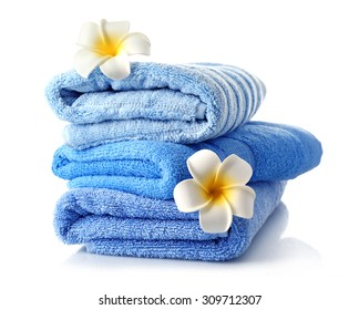 Stack of colorful towels isolated on white