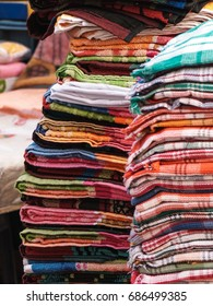 Stack of colorful towels at the outdoor asian shop. New Delhi. India.