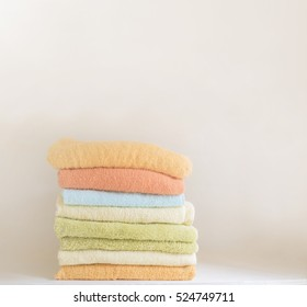 stack of colorful towels - studio shot - text space