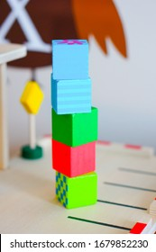 A stack of colorful toy cubes on a blurred background