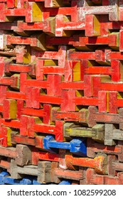 Stack of colorful wooden beams for building market stalls in the Netherlands