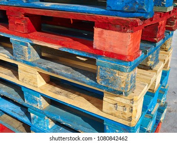 Stack of colorful wooden pallets creative use of daily items