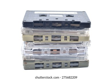 stack of compact cassettes isolated on white background