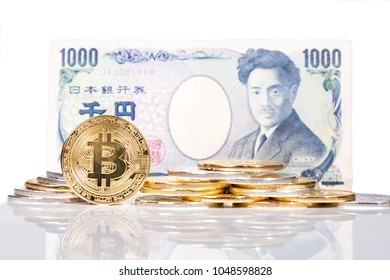 Stack of conceptual cryptocurrency bitcoin with Japanese Yen bill white background