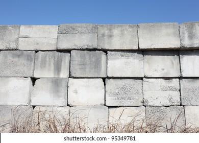 stack of concrete blocks, construction site against a blue sky