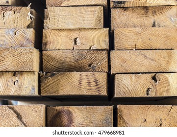 A stack of construction planks close up.