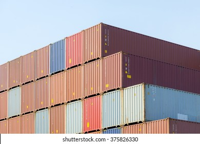 the stack of container in the ship yard at the port before shipping to oversea