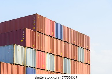 The stack of container in the ship yard at the port before export process