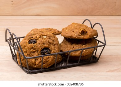 stack of cookies and glass of milk on wooden background (selective focus on cookies)