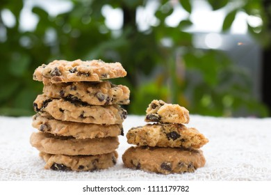 stack of cookies on wooden table.