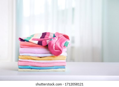 Stack of cotton colorful clothing,stacked clothes,kid's apparel.Cotton laundry empty copy space.