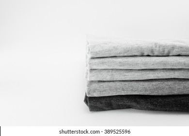 stack of cotton t-shirt on isolate background