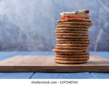Stack of crackers topped with Wensleydale cheese.