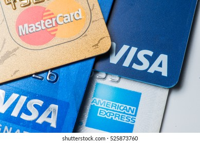 Stack of credit cards with MasterCard and Visa logos on white background(for editorial use only)